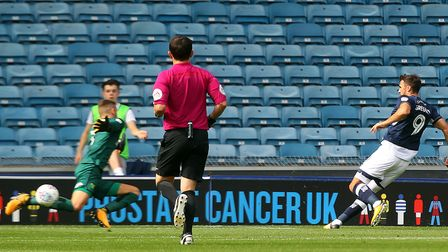 Lee Gregory of Millwall scores his side's first goal during the Sky Bet Championship match at The De