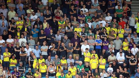 The traveling Norwich fans look dejected during the Sky Bet Championship match at The Den, London. P