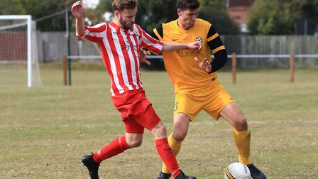 Action from the game between Waveney (gold) and Premier Division early leaders Norwich Ceyms, who ra