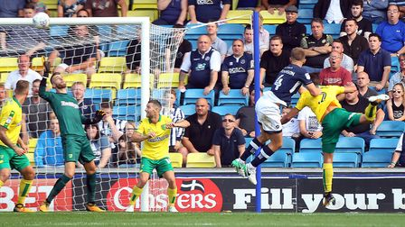 Shaun Hutchinson notches Millwall's fourth goal against Norwich City at The Den. Picture: Paul Chest