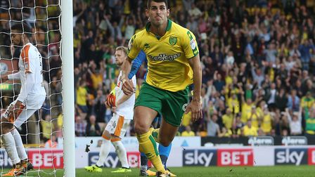 Nelson Oliveira turns to celebrate his late leveller against Hull at Carrow Road. Picture by Paul Ch