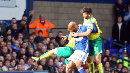 Grant Hanley battles with David McGoldrick after coming on as a second half substitute for Christoph