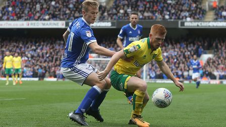 Harrison Reed shields the ball away from Ipswich's Flynn Downes.