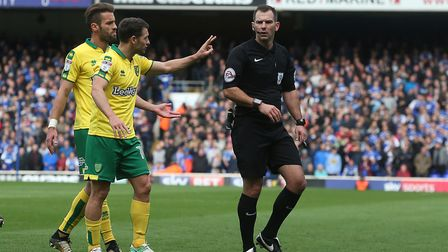 Wes Hoolahan complains to the referee after being penalised for fouling Tristan Nydam.