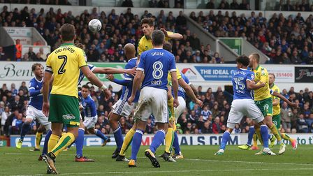 Timm Klose rises highest to head for goal at Portman Road.