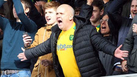 A Norwich fan celebrates victory at the end of the Sky Bet Championship match at Portman Road, Ipswi