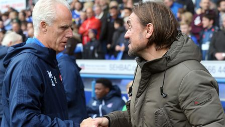 Ipswich Town boss Mick McCarthy greets Norwich City head coach Daniel Farke before kick-off at Portm