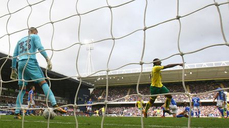 Cameron Jerome of Norwich runs off to join in the celebrations of his side's 1st goal during the Sky