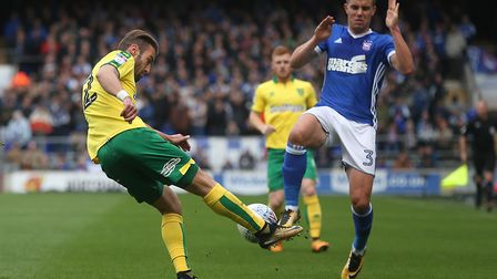 Ivo Pinto of Norwich and Jonas Knudsen of Ipswich Town in action during the Sky Bet Championship mat