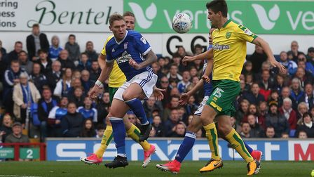 Timm Klose of Norwich and Martyn Waghorn of Ipswich Town in action during the Sky Bet Championship m