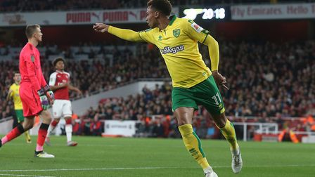 Josh Murphy turns away in triumph after putting the Canaries ahead at the Emirates Stadium. Pictures