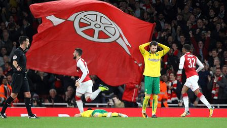 James Husband of Norwich looks dejected as Edward Nketiah of Arsena celebrates scoring his sides 1st
