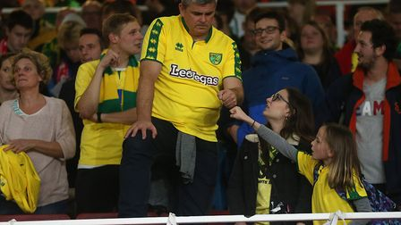 The traveling Norwich fans look dejected at the end of the Carabao Cup match at the Emirates Stadium