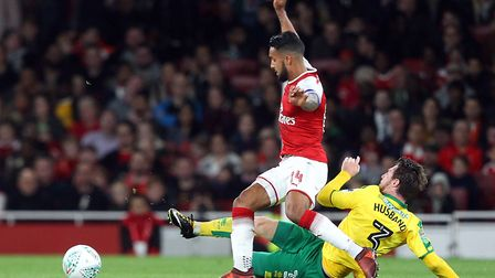 Theo Walcott of Arsenal and James Husband of Norwich in action during the Carabao Cup match at the E