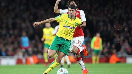 Nelson Oliveira of Norwich is fouled by Mohamed Elneny of Arsenal but only gets a yellow card from R