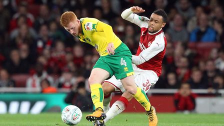 Harrison Reed of Norwich and Francis Coquelin of Arsenal in action during the Carabao Cup match at t