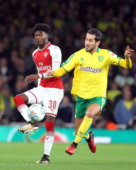 Ainsley Maitland-Niles of Arsenal and Mario Vrancic of Norwich in action during the Carabao Cup matc