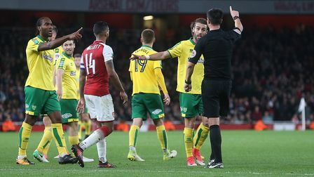 The Norwich players appeal for a penalty to Referee Andy Madley afterJames Husband of Norwich is bro