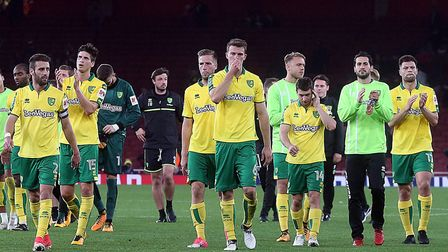 The Norwich players go over and applaud the fans at the end of the Carabao Cup match at the Emirates