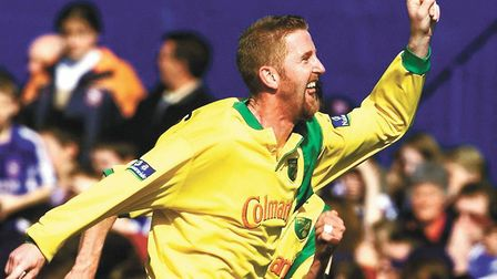 Iwan Roberts celebrates the first of his two goals in Norwich City's 2-0 win at Portman Road in Marc