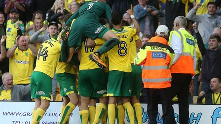Angus Gunn joins in with the celebrations in front of the South Stand after Nelson Oliveira's late e
