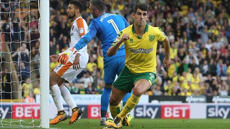 The face says is all as Nelson Oliveira wheels away to celebrate his late, late equaliser against Hu