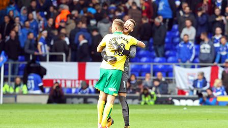 Marco Stiepermann and Angus Gunn embrace after Norwich's 1-0 win over fierce rivals, Ipswich Town. P