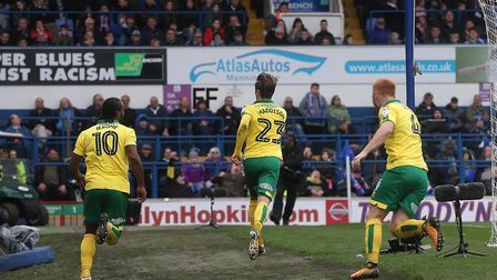 James Maddison lets the Ipswich Town fans what's just happened as Norwich City take the lead at Port