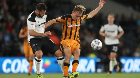 Hull City's rising star, Jarrod Bowen, right, battling with Derby's Bradley Johnson. Picture: PA