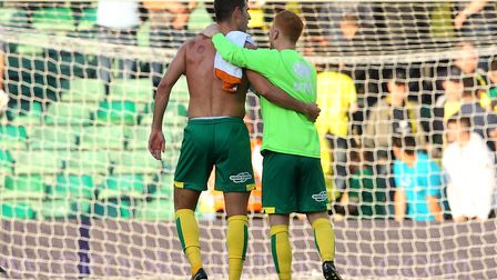 Nelson Oliveira and Harrison Reed enjoy the final whistle celebrations following Norwich City's poin