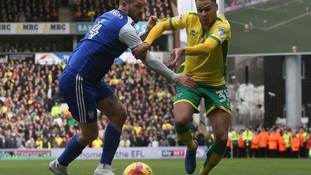 Ipswich captain Luke Chambers tries to keep up with Norwich winger Josh Murphy during last season's