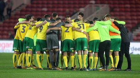 Head coach Daniel Farke leads a spontaneous post-match huddle with his Norwich City squad following