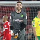 Angus Gunn of Norwich and the Norwich players celebrate victory at the end of the Sky Bet Championsh
