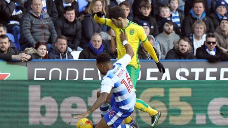 Liam Moore challenges Nelson Oliveira during the game at Reading last season. Picture: Paul Chestert