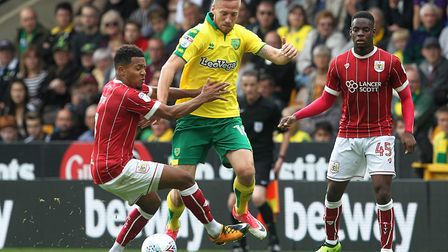 Korey Smith of Bristol City and Marco Stiepermann of Norwich in action during the Sky Bet Championsh