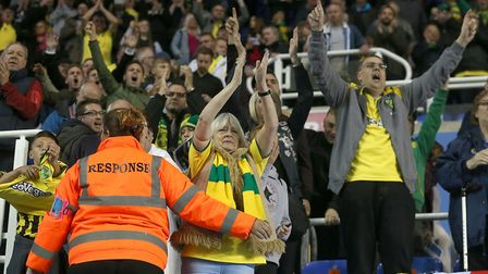The traveling Norwich fans celebrate victory at the end of the Sky Bet Championship match at the Mad