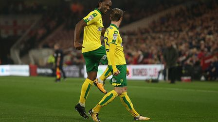 James Maddison celebrates scoring Norwich City's winning goal at Middlesbrough with Cameron Jerome.
