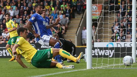 Nelson Oliveira slides home Norwich City's winner against Birmingham. Picture by Paul Chesterton/Foc