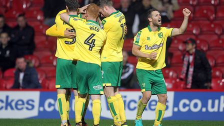 Wes Hoolahan salutes the travelling fans as the Canaries celebrate Mario Vrancic's second goal of th