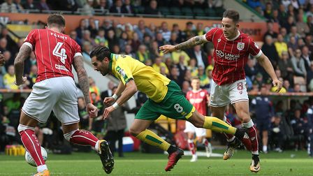Mario Vrancic of Norwich is fouled by Josh Brownhill of Bristol City during a 0-0 draw at Carrow Roa