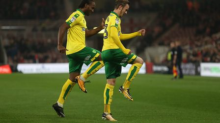 James Maddison has a knee-up with Cameron Jerome after firing the Canaries into an early lead at the