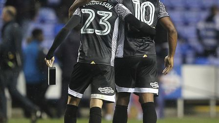 Cameron Jerome gives James Maddison a hand off the Reading pitch following their good night's work.