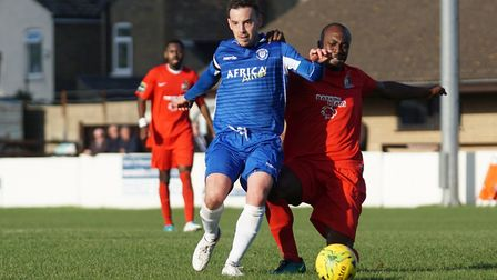 Lowestoft captain Adam Smith battling for possession against Harrow Borough. Picture: Shirley D Whit