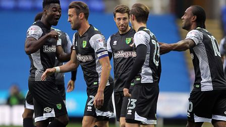 The expression on Alex Tettey's face says it all, as James Maddison's team-mates celebrate his stunn