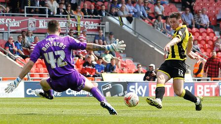On-loan Norwich City goalkeeper Remi Matthews during his loan spell with Doncaster, against a former
