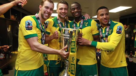 City players celebrate play-off success in the Wembley dressing room. From left, Steven Whittaker, R