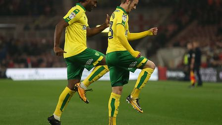 James Maddison celebrates his stunning strike with Cameron Jerome during Norwich City's 1-0 win at M