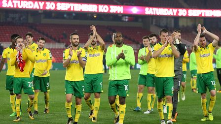 The Norwich players celebrate victory at the end of the Sky Bet Championship match at the Riverside