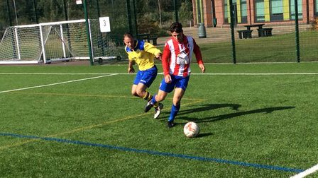 Norwich Sunday leage acution between DE FC (red/blue) and Acle Rangers. Picture: Ben Casey