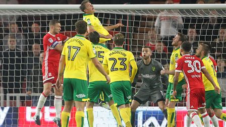 Christoph Zimmermann heads clear as Norwich City cling on to their three points at Boro. Picture by